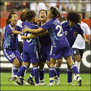 Japan's players celebrate their late equaliser