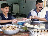 Iraqi refugee Yussuf and son Saif in Damascus, Syria (photo Andrew North)