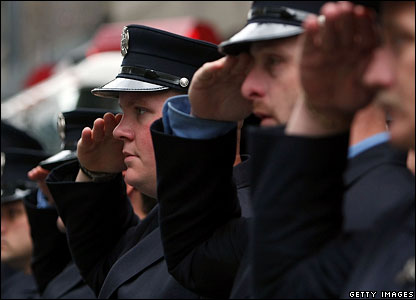 Manhattan firefighters salute during a moment of silence