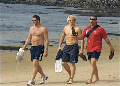 Ian Gough, Alix Popham and Chris Horsman stroll along the beach