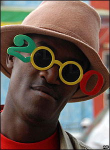 A man wears novelty sunglasses