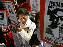 Relatives of those killed during the military regime shout slogans outside La Moneda presidential palace in Santiago, Chile