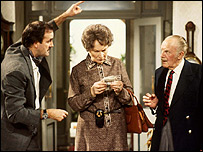John Cleese as Basil Fawlty, Joan Sanderson as Mrs Richards, and Ballard Berkeley as Major Gowen