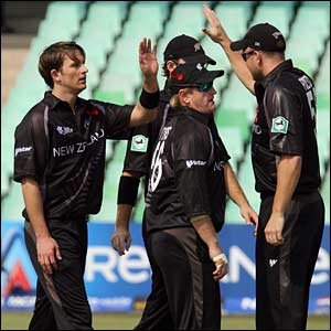 Shane Bond celebrates the wicket of Tanmay Mishra