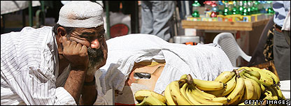 Man looking at bananas