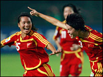 Li Jie celebrates after scoring China's opening goal against Denmark