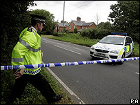 Police seal off roads around the farm