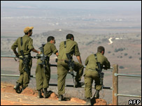 Israeli army officers look towards Syria from an observation post in the Golan Heights  (file photo)