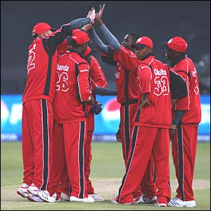 Zimbabwe celebrate the wicket of Adam Gilchrist