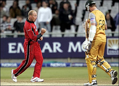 Gary Brent (left) celebrates bowling Brett Lee for 12