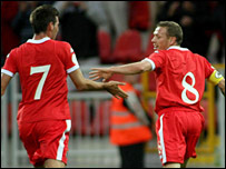 Joe Ledley gets thanks after his pass sent Craig Bellamy clear to score Wales' third goal