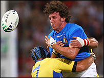Italy's Mauro Bergamasco is tackled by Alexandru Manta