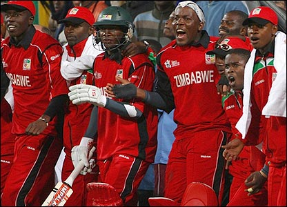 The Zimbabwe bench reacts to the winning runs being scored
