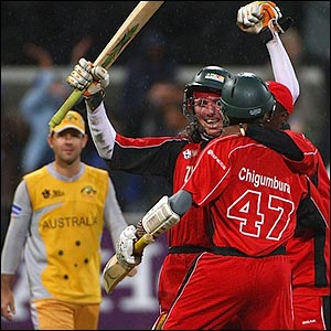 Brendan Taylor and Elton Chigumbura celebrate a famous win for Zimbabwe while Ricky Ponting watches on