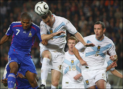 Florent Malouda is beaten by Stephen McManus