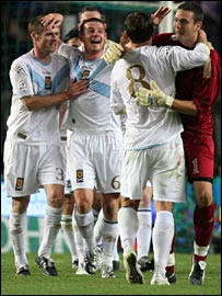 Scotland's players celebrate at the final whistle