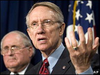 Democratic Senators Carl Levin and Harry Reid (r)