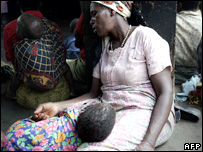 File photograph of a Malawian woman and her grandson at an emergency nutrition centre in Malawi