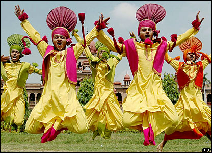 Youths perform the traditional Punjab Bhangra dance at the opening ceremony of a police academy athletics carnival at Khalsa College in Amritsar, India