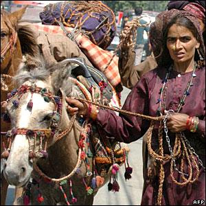 Kashmiri Gujjars (nomads) walk along Dal Lake in Srinagar, Kashmir