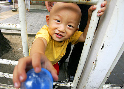 A two-year-old boy plays outside a children's hospital in Beijing, China