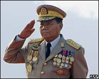 Myanmar's leader Senior General Than Shwe salutes during  Armed Forces Day