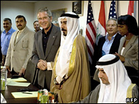 President George Bush shakes hands with Abdul Sattar Abu Risha