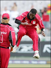 Brendan Taylor and Elton Chigumbura celebrate the dismissal of Luke Wright