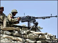 Pakistani Army soldiers take position at Sholam Post, South Waziristan April 2007