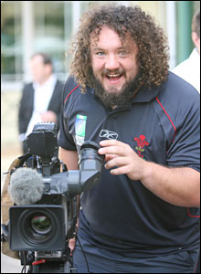 In the midst of the media glare, Wales prop Adam Jones tries his hand at camera work
