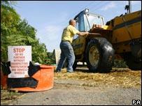 Farmer sprays tractor