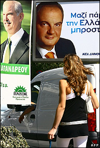 A woman passes campaign posters in Athens