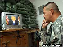 US soldier in Baghdad watches President Bush's address on TV