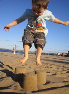 Joe McGill jumping on sandcastles