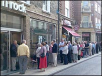 Northern Rock customers queuing outside a branch in Cambridge