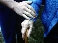 Hands of an elderly woman and her carer