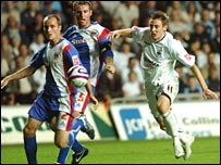 Darryl Duffy (right) in action for Swansea against Carlisle