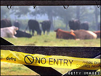 Defra 'No entry' tape across a Surrey farm