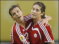 Christine Sinclair (l) and Kara Lang