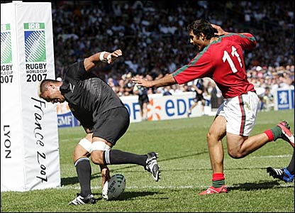 Jerry Collins scores a try for New Zealand against Portugal