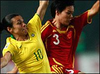 Brazil goalscorer Marta (left)