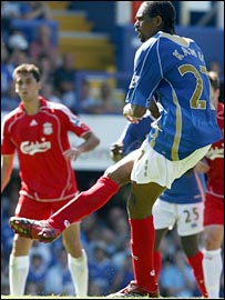 Portsmouth striker Kanu takes a penalty against Liverpool, which is saved by Pepe Reina
