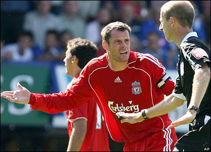 Liverpool captain Jamie Carragher protests to referee Mike Riley