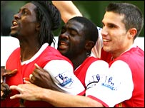 Arsenal players celebrate after Emmanuel Adebayor scores