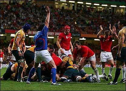 The referee gives a try to Wales