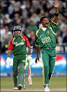 Makhaya Ntini (right) successfully appeals for a leg before decision against Nazim Uddin (left)
