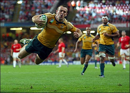 Wales' old nemesis Chris Latham celebrates a brace of tries to seal Australia success