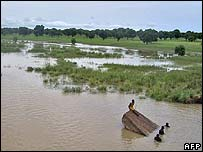 A group of men struggle to swim to safety in Upper East Ghana - 7/09/07