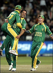 South Africa's Johan Van der Wath (centre) is congratulated after dismissing Shakib Al Hasan
