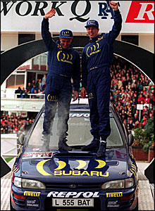 Colin McRae (right) and co-driver Derek Ringer celebrate winning the 1994 GB Rally